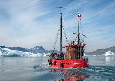 Blue Ice boat Puttut among icebergs near Qooroq ice fjord in Narsarsuaq 04