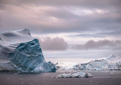 Icebergs on a cloudy day in the Disko Bay in North Greenland